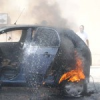 कार का अंदरूनी हिस्सा आग से राख