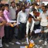 रिपोर्ट व आदेशों की कर्मचारियों ने जलाई होली