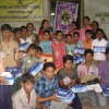निराश्रित विद्यार्थियों को स्कूल शूज व स्टेशनरी वितरित